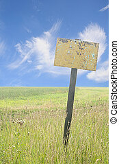 wooden sign of a green land with a blue sky