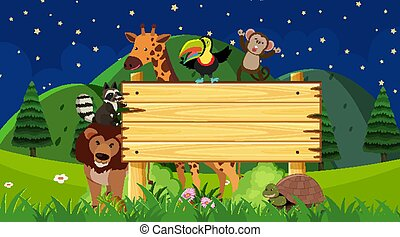 Wooden sign with animals at night time