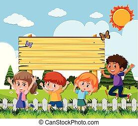 Wooden sign with happy children in garden