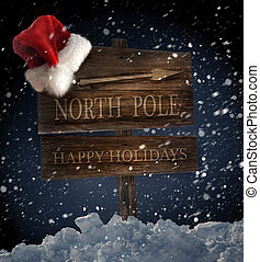Weathered wooden sign with santa hat on snowy background