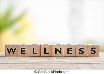 Wooden sign with the word wellness