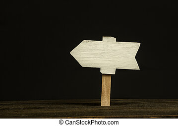 Wooden signboard on black background. Front view, closeup