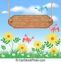 Wooden signboard on the meadow