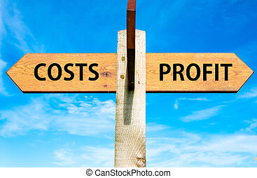 Wooden signpost with two opposite arrows over clear blue sky, Costs and Profit, Business profitability conceptual image