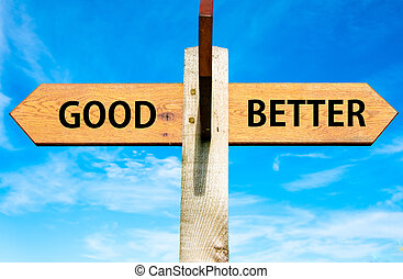 Wooden signpost with two opposite arrows over clear blue sky, Good versus Better messages, Lifestyle change conceptual image