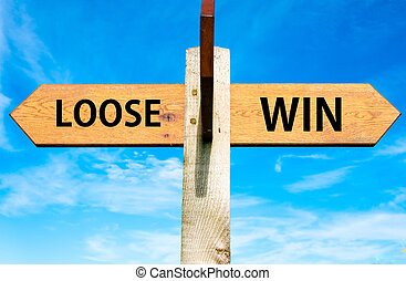 Wooden signpost with two opposite arrows over clear blue sky, Loose versus Win messages, Lifestyle change conceptual image