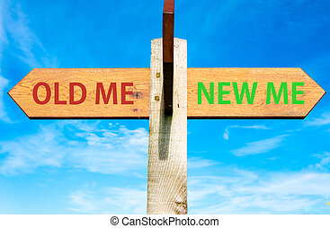 Wooden signpost with two opposite arrows over clear blue sky, Old Me and New Me, Life change conceptual image
