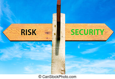 Wooden signpost with two opposite arrows over clear blue sky, Risk versus Security messages, Lifestyle change conceptual image