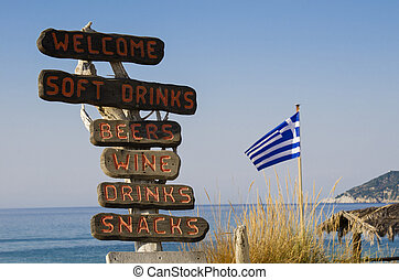 Wooden signs on the beach in greece