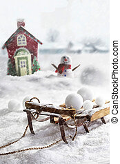 Wooden sled and snowballs with wintery background - Wooden...