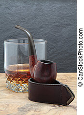 smoking pipe and whisky