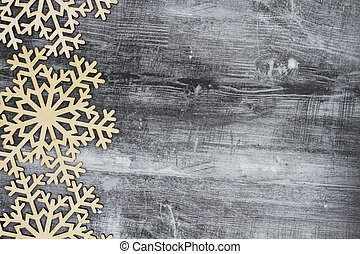 Wooden snowflakes on a weathered wood background