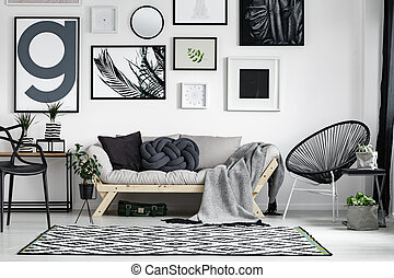 Wooden sofa with pillows