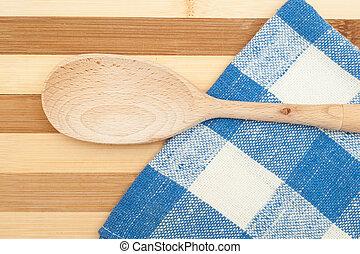 Wooden spatula on a blue dishcloth