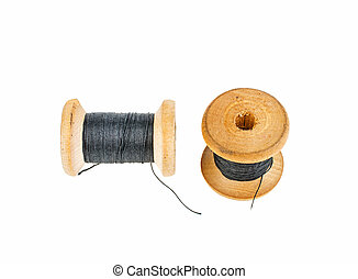 Wooden spool with black thread on a white background