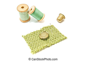 wooden spools of thread, button and thimble