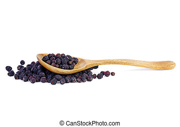 Wooden spoon and dried aronia berries isolated on white ...