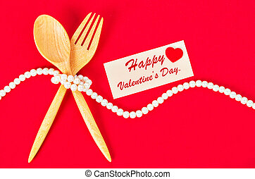Wooden spoon and fork with blank greeting card.