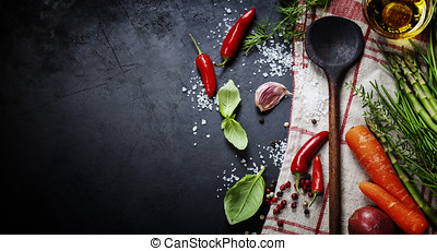 Wooden spoon and ingredients on dark background. Vegetarian...