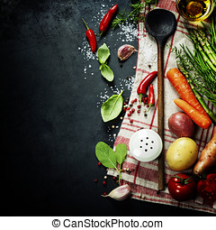 Wooden spoon and ingredients on dark background. Vegetarian...