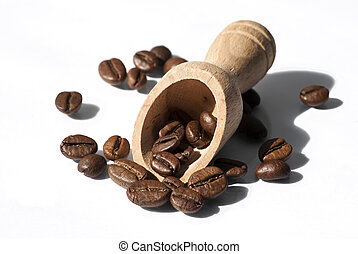 a wooden spoon into coffee beans