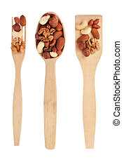 Wooden spoon, fork, shovel with nuts