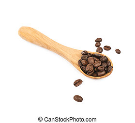 Wooden spoon full of coffee isolated