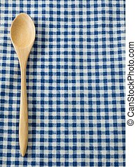Wooden Spoon on Blue Checked Napkin Pattern