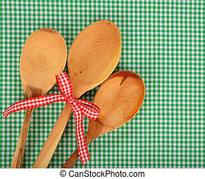 Wooden spoon on green napkin