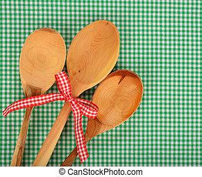 Wooden spoon on green napkin