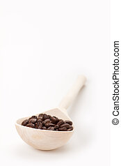 wooden spoon with coffee beans, isolated