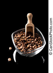 Wooden spoon with coffee beans.