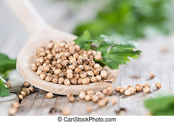 Wooden Spoon with Coriander seeds (detailed close-up shot)
