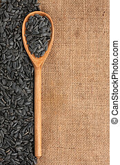 wooden spoon with sunflower seeds