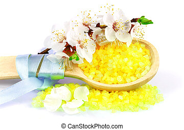 Wooden spoon with yellow bath salt