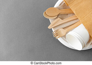 wooden spoons, forks and knives on paper plate