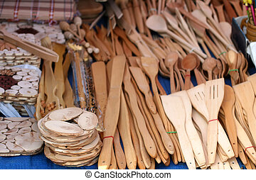 Wooden spoons, forks and various kitchen utensils.