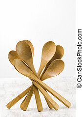 wooden spoons isolated on white background