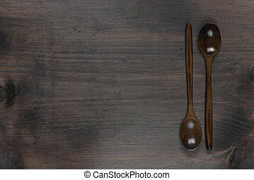 Wooden spoons on a dark background
