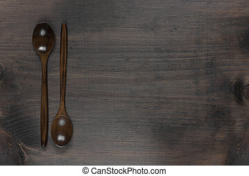 Wooden spoons on a dark wooden background
