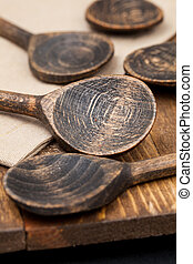 wooden spoons on table background