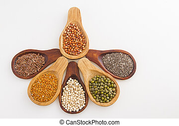 wooden spoons with assorted grains of super foods, gluten free