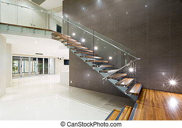 Wooden staircase in modern home - Contemporary mansion with...
