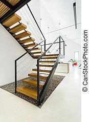 Wooden staircase in white kitchen
