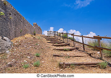 Wooden staircase next to the stone fortress wall