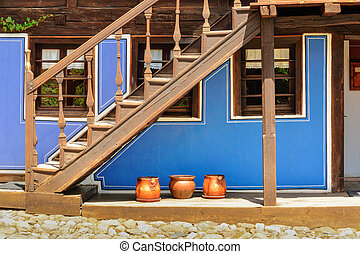 Wooden stairs and an old house in Koprivshtitsa Bulgaria