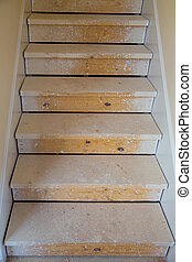 Wooden stairs in new house construction