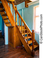 Wooden stairs in small country house