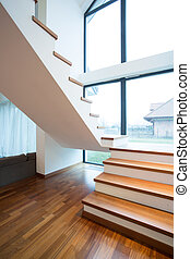 Wooden stairway in detached house - Close-up of wooden ...