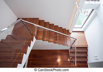 Wooden stairway in luxury house - Close-up of wooden ...